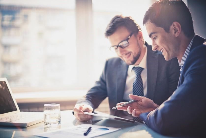 Business men looking over paperwork